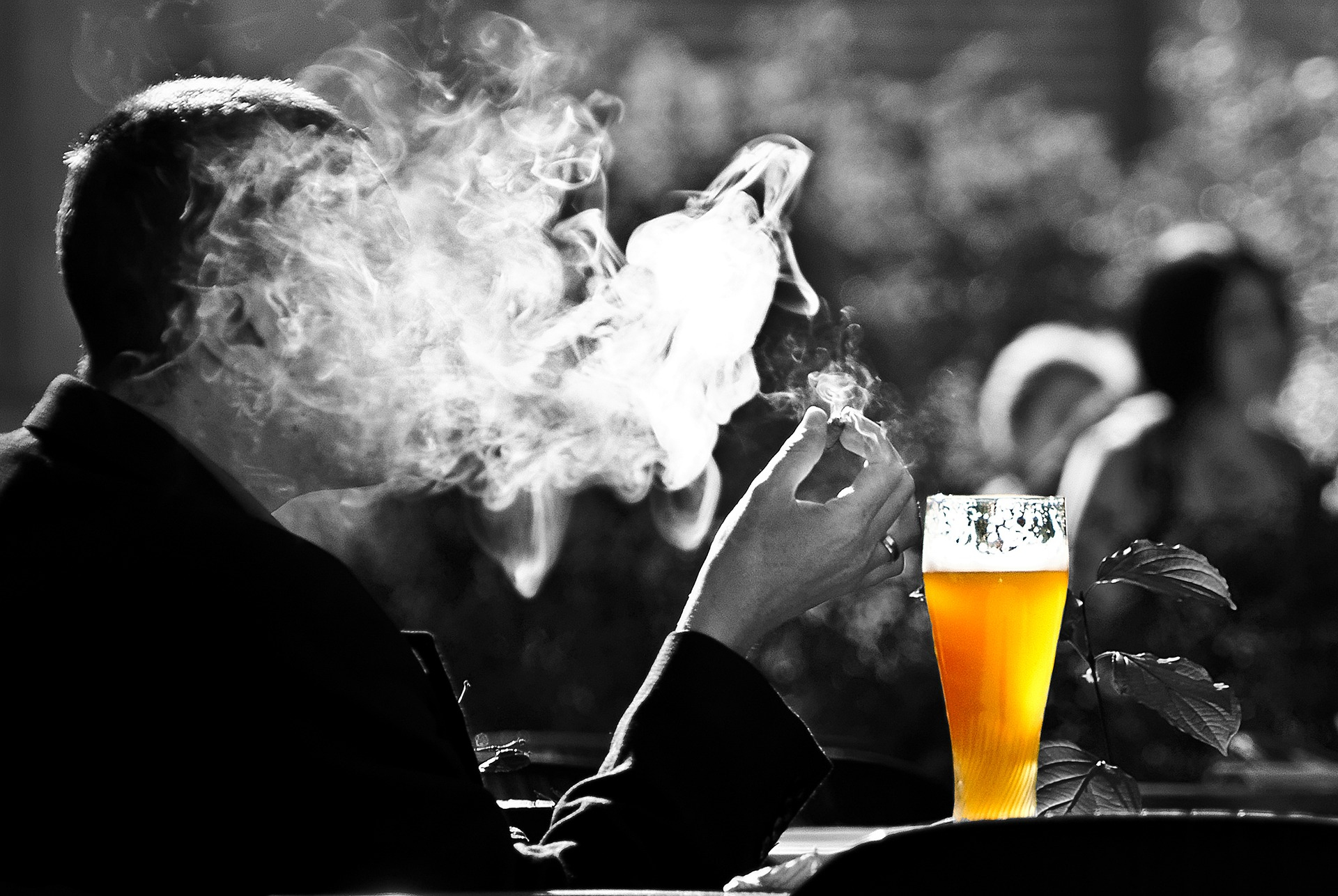 Man smoking a cigarette and drinking beer