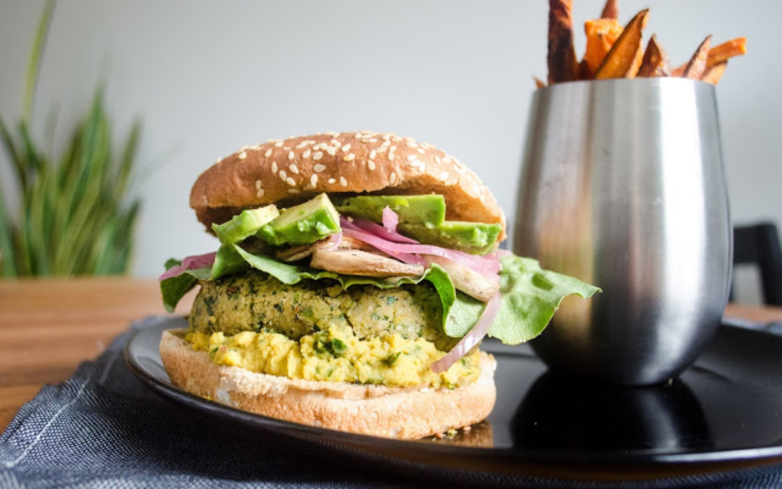 Kale and chickpea burger with sweet potato fries