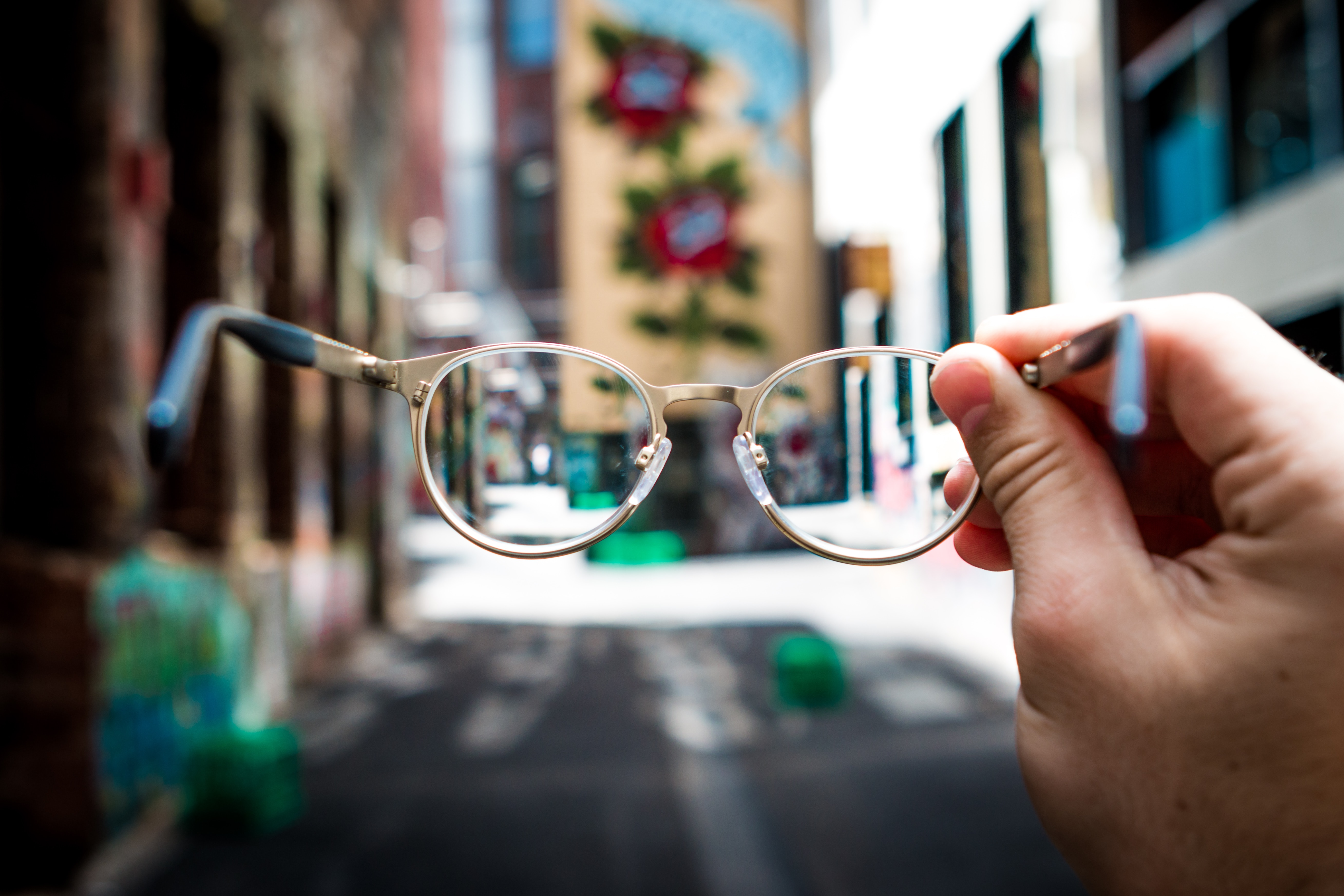 Eyeglasses Held Up Against Background