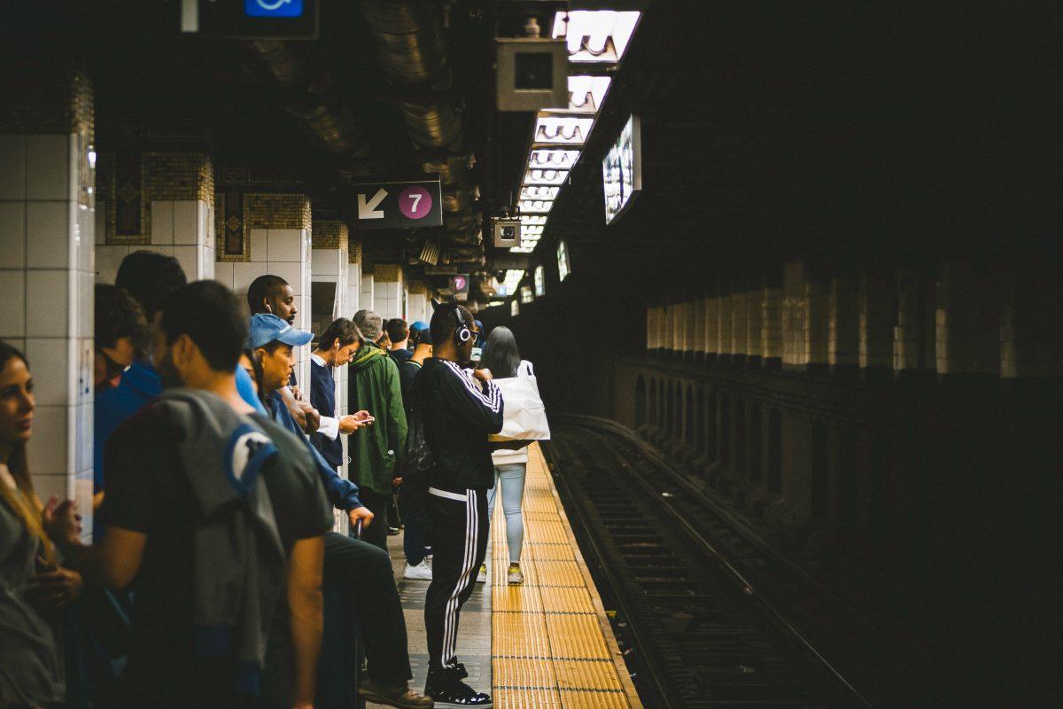 People Standing on Subway Platform