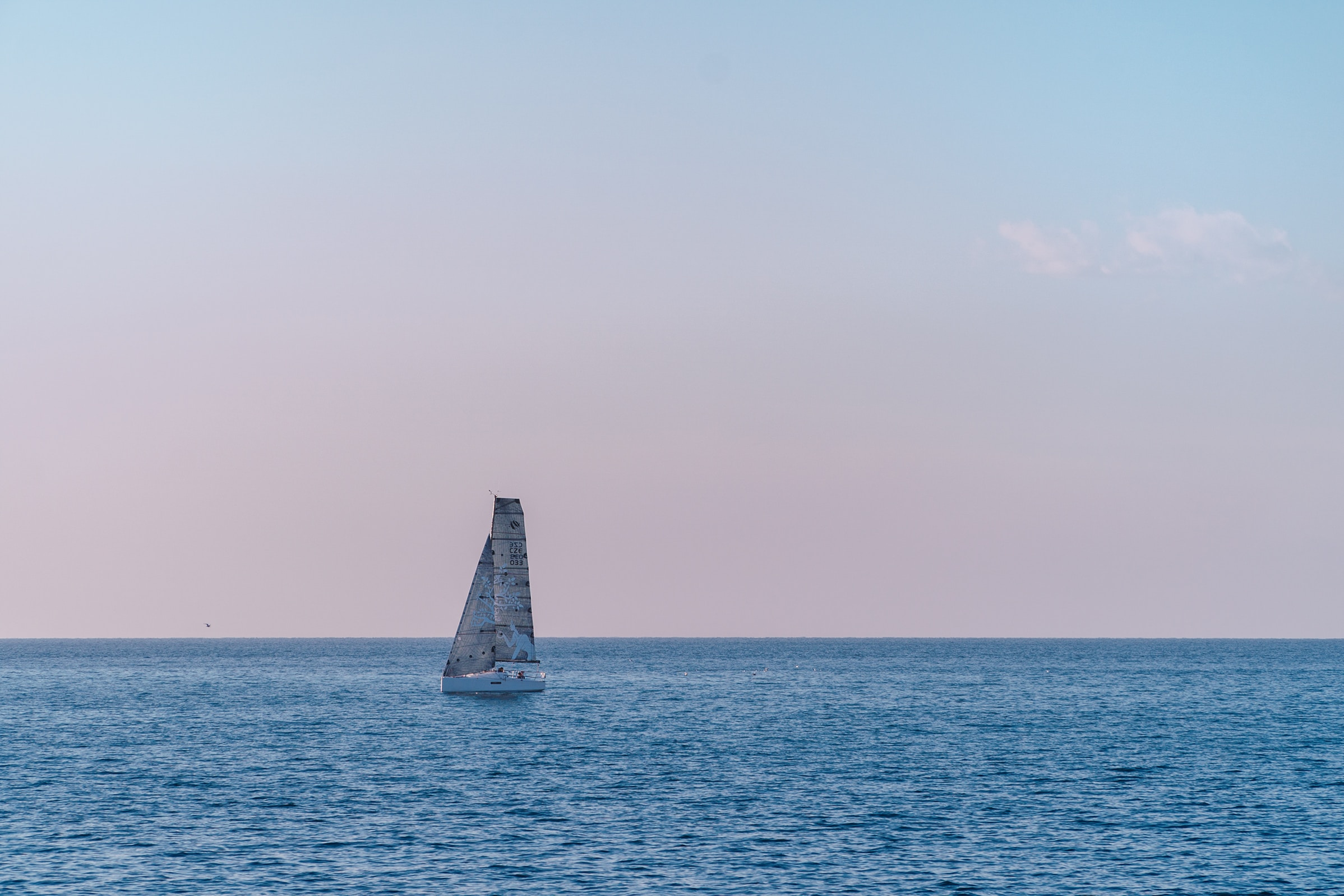 Sailboat at Sunset in Open Ocean