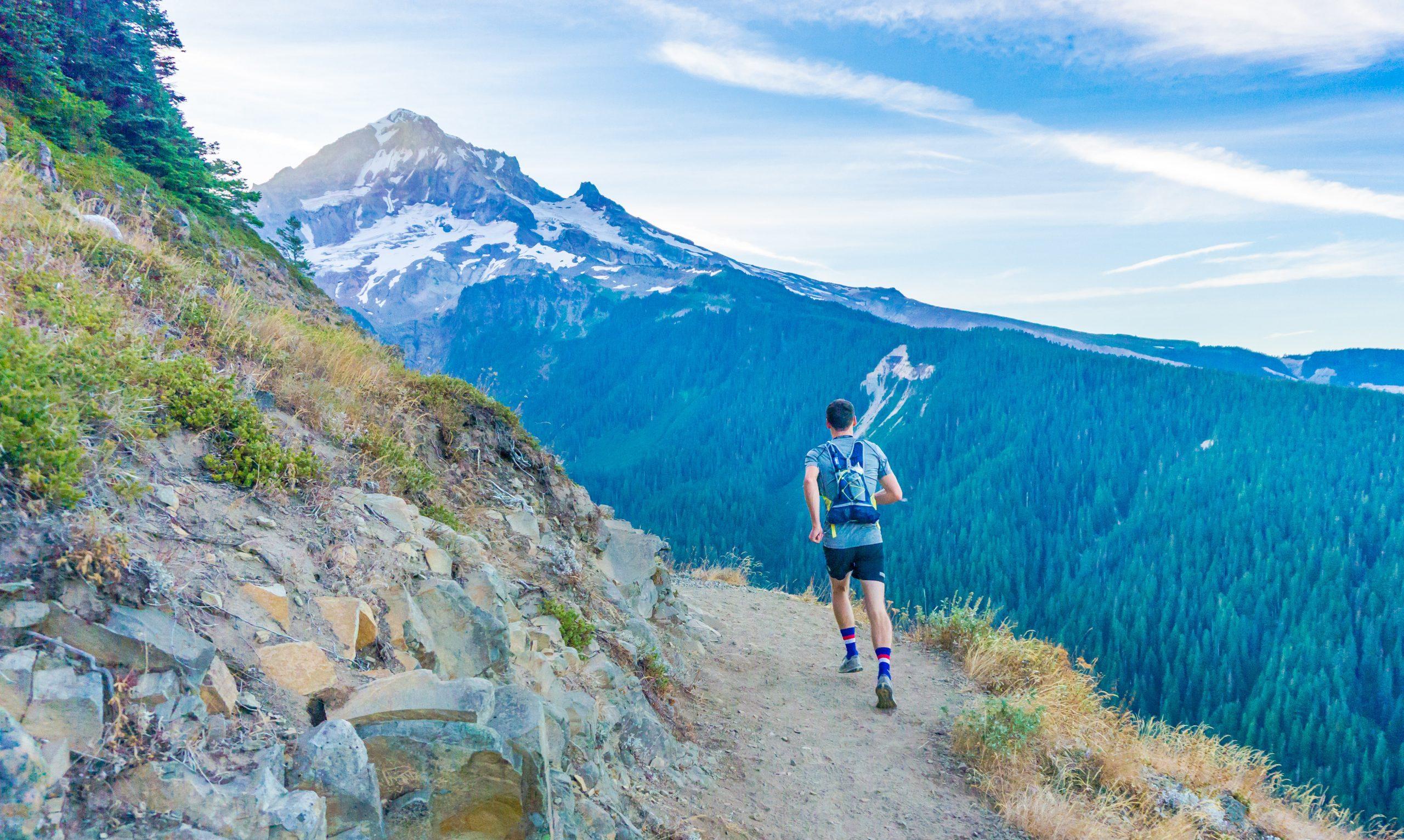 Man Running Alongside Mountain