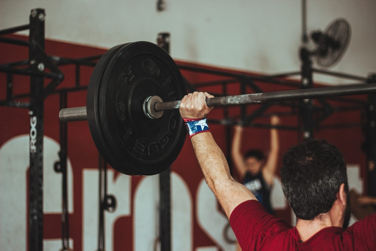 Man Lifting Barbell at the Gym