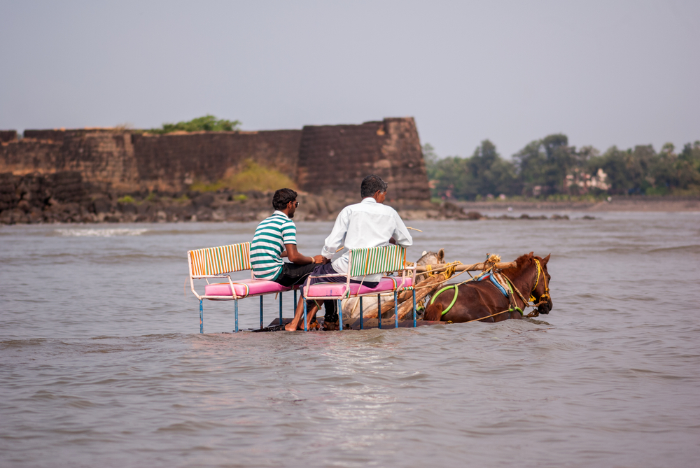 Horse carriage in water at Alibag beach India
