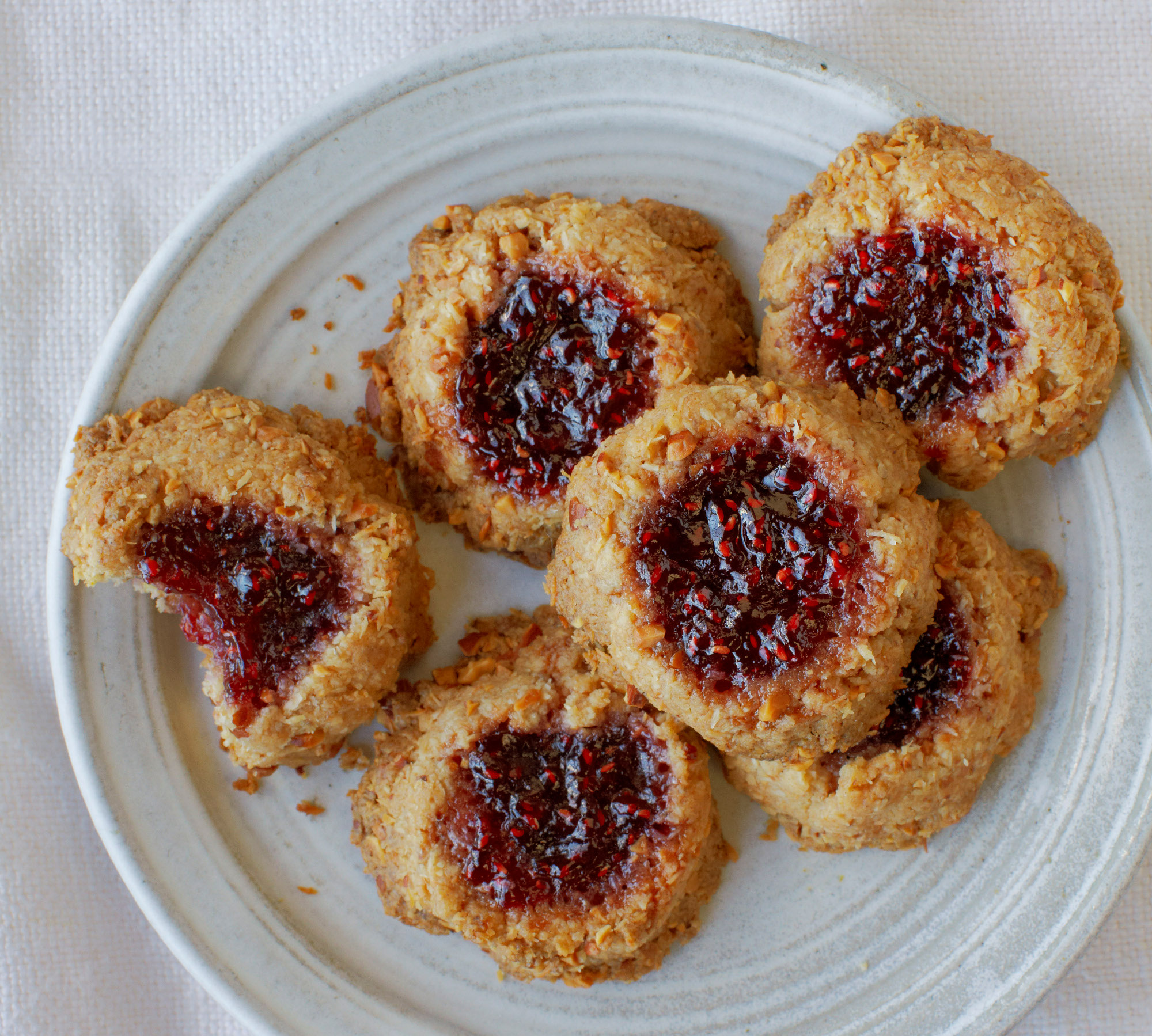 Coconut, Almond, and Raspberry Jam Thumbprint Cookies