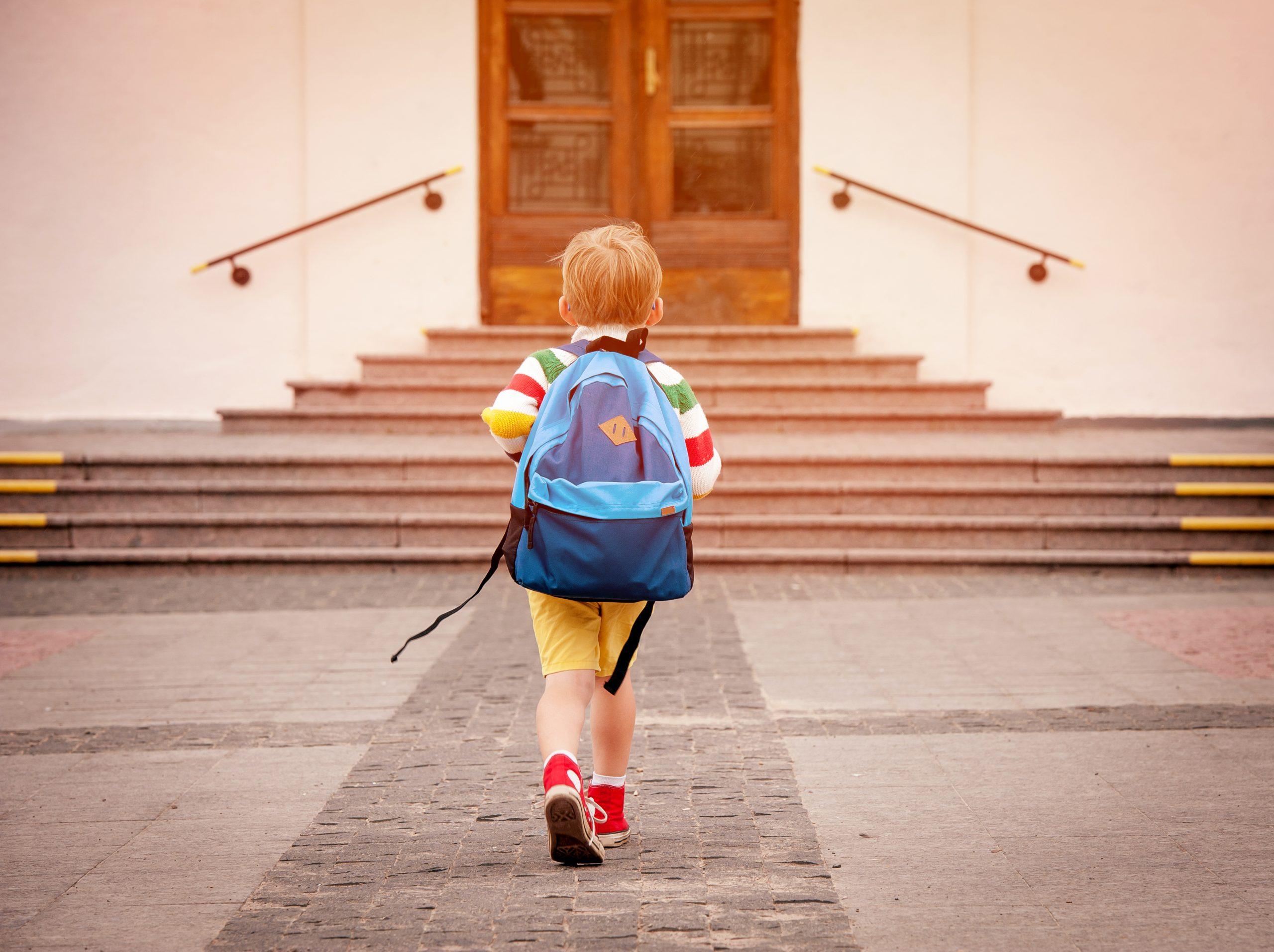 kid walking into school