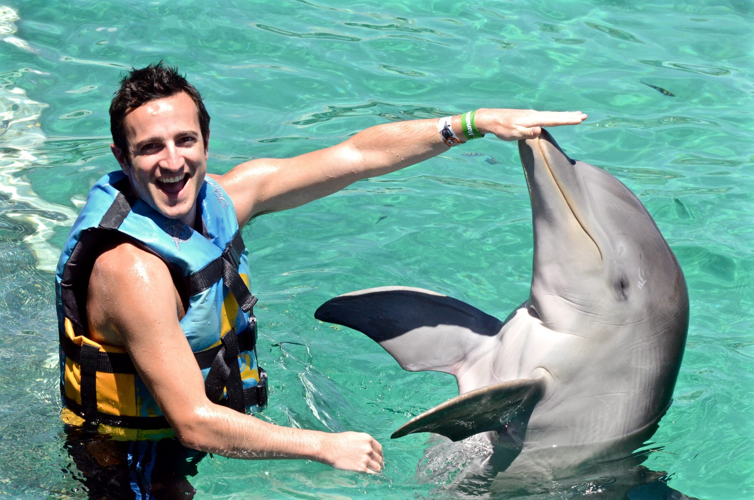 man with dolphin