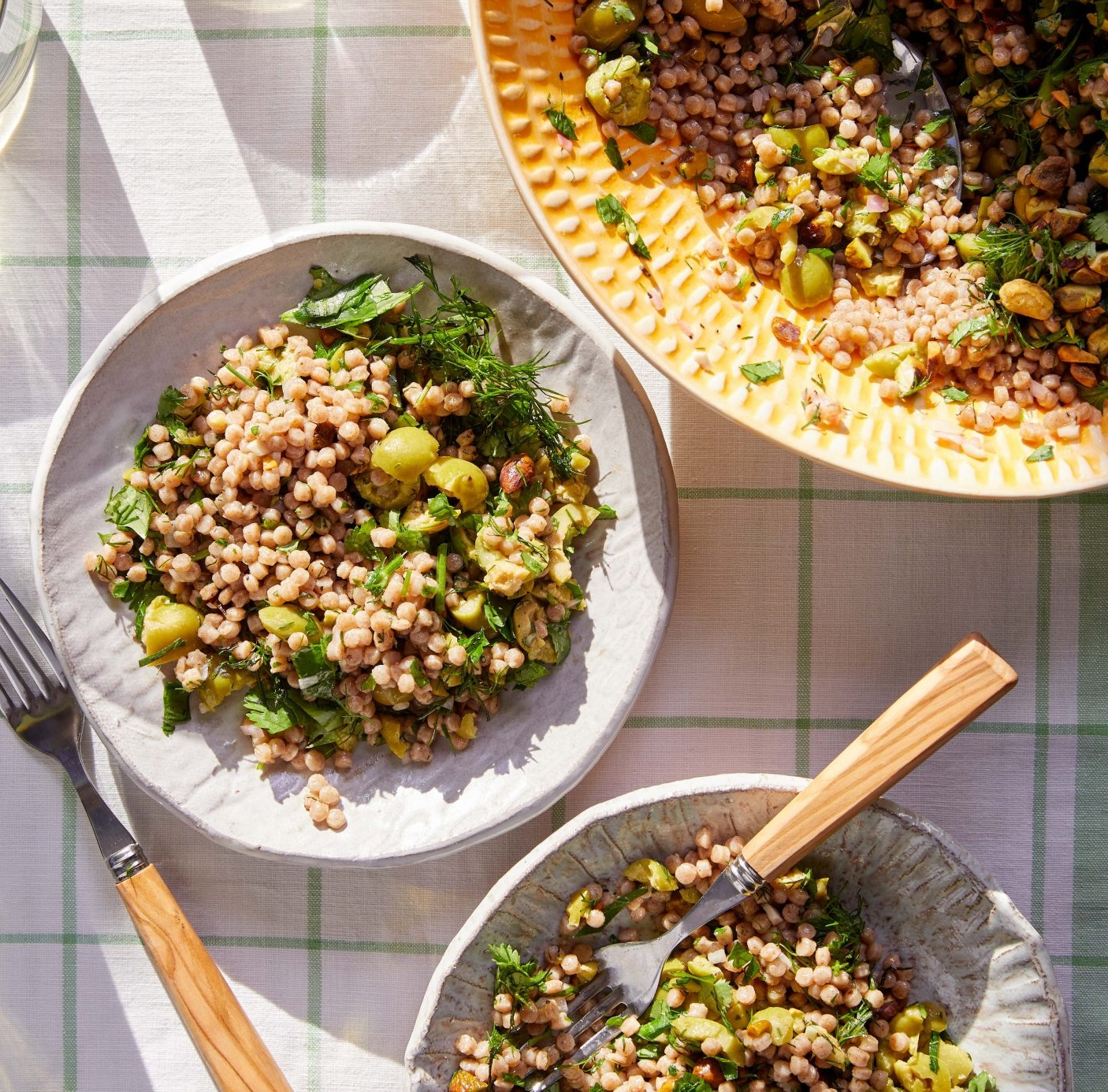 Israeli Couscous Salad with Herbs, Green Olives, and Pistachios