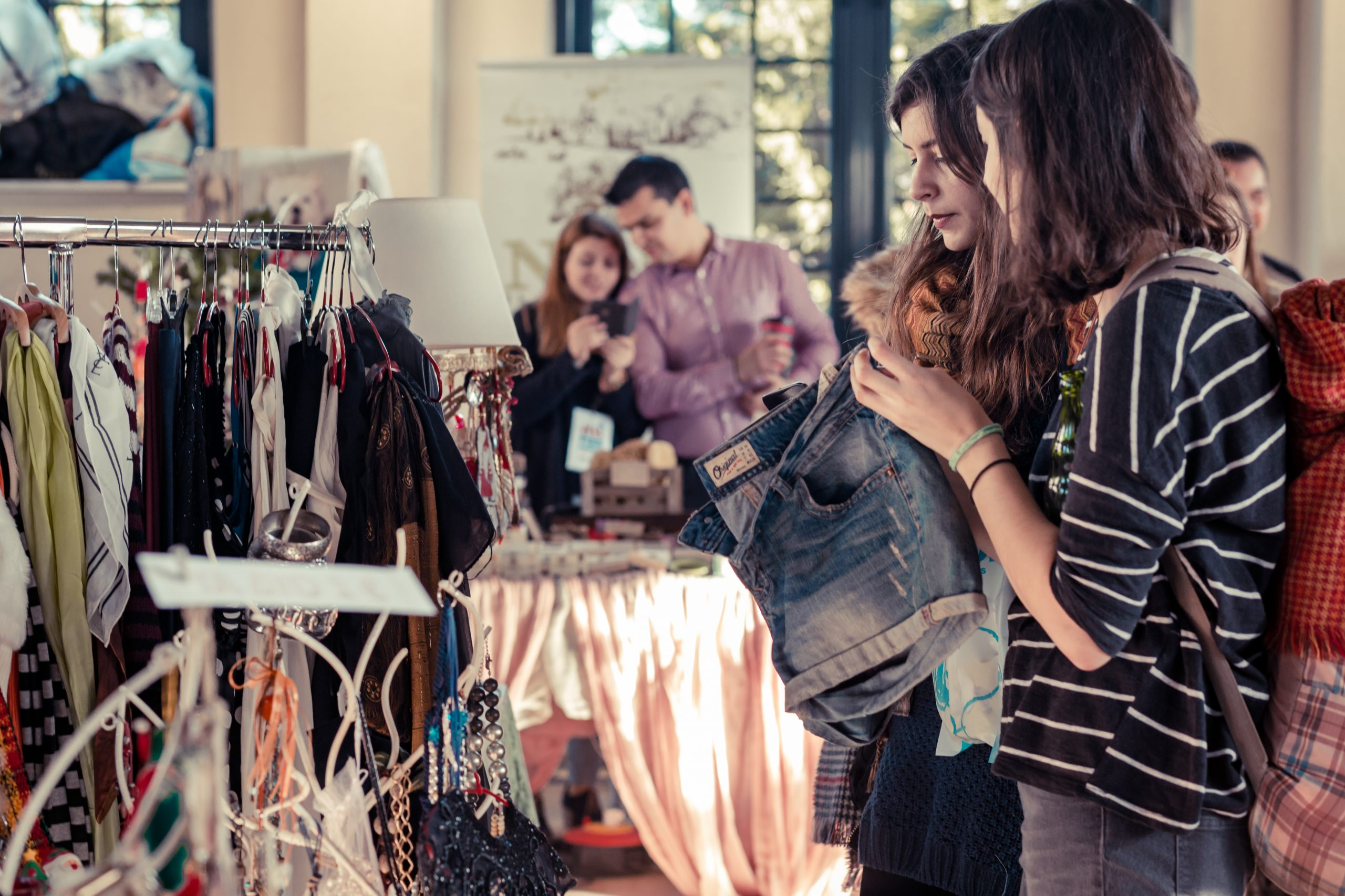 Shoppers purchasing secondhand clothing
