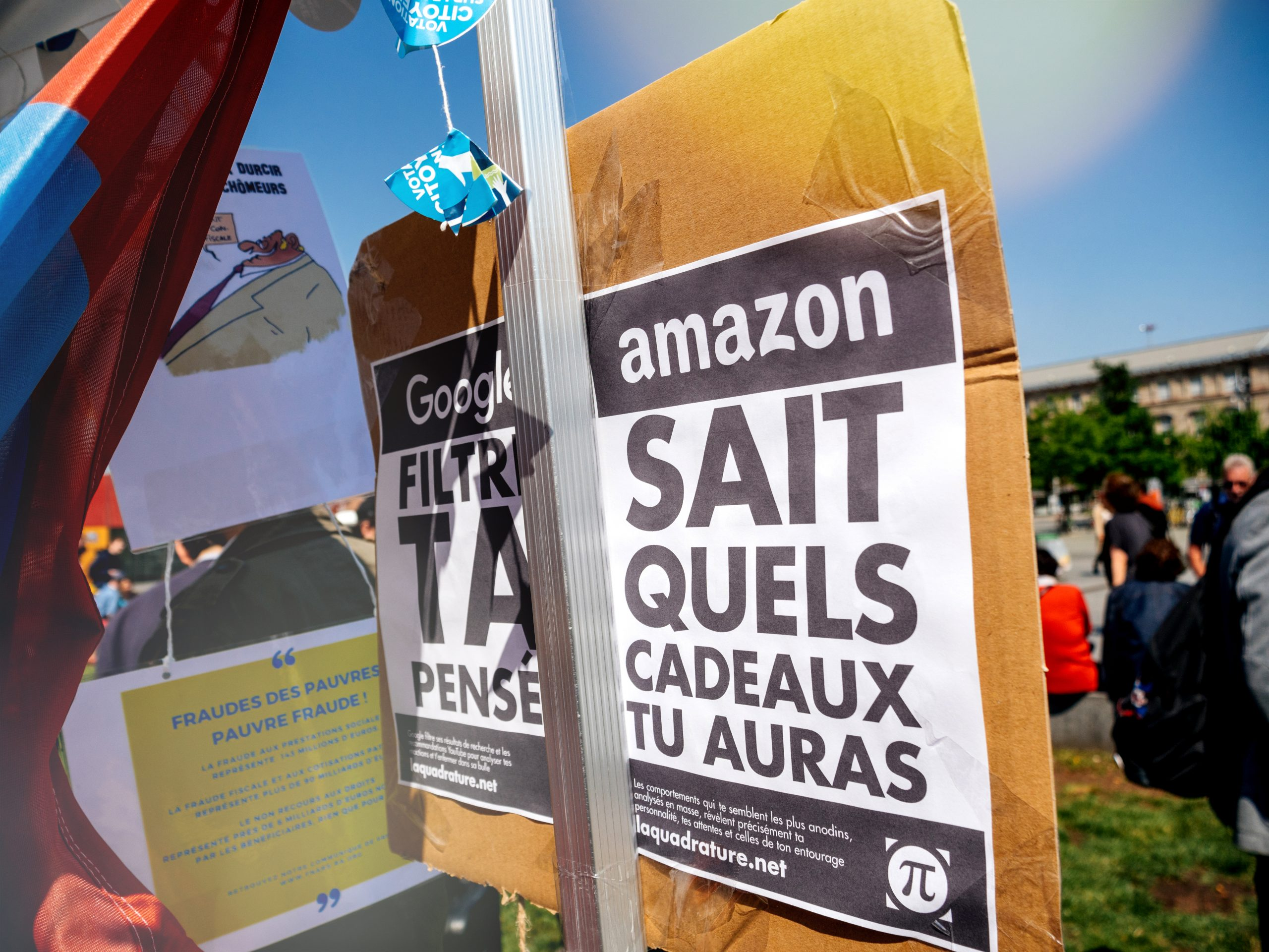 STRASBOURG, FRANCE - MAY 5, 2018: People making a party protest Fete a Macron party for Macron in front of Gare de Strasbourg - messages against Amazon, Google and Apple