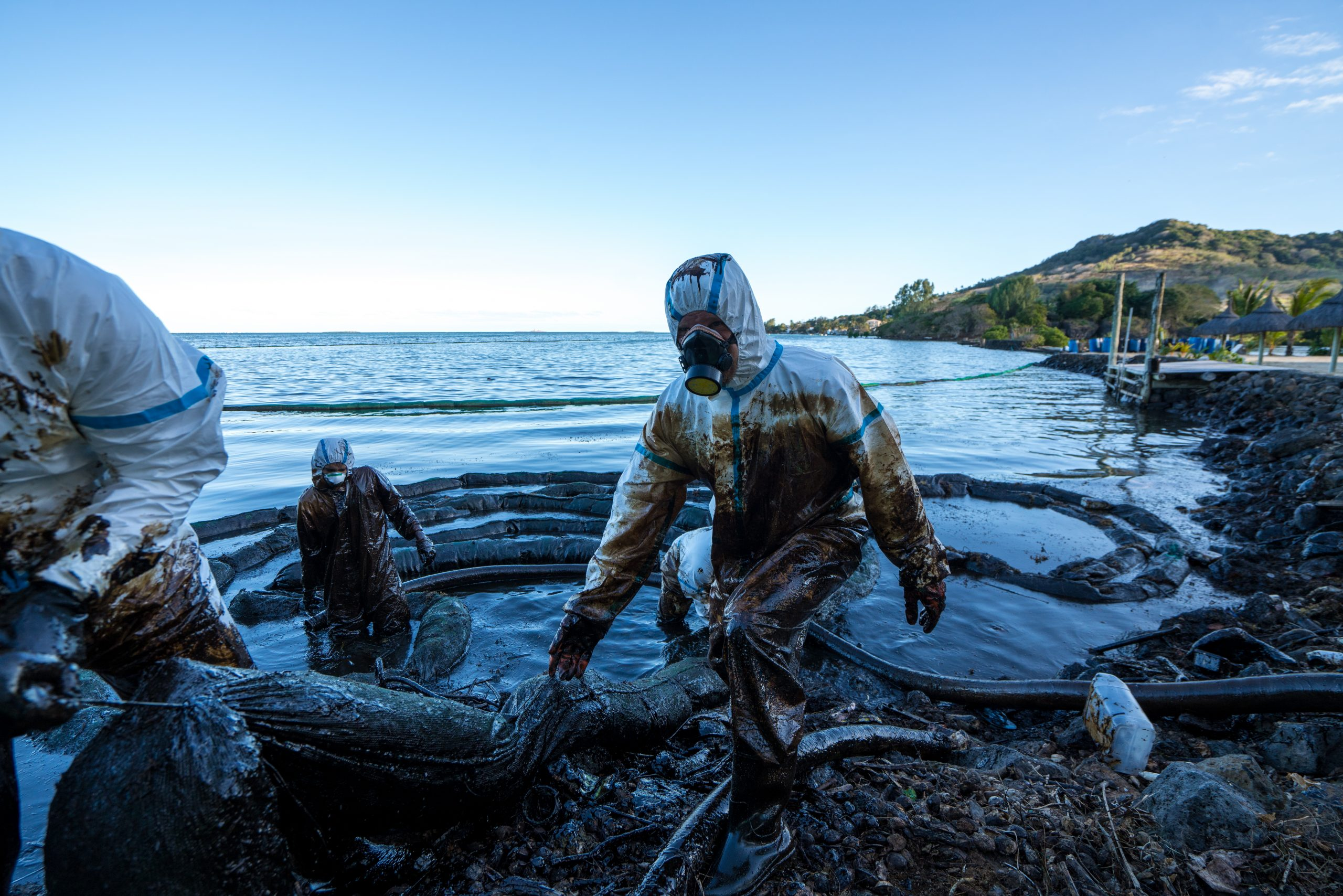 Volunteers clean the ocean coast from oil after a tanker wreck. Mauritius