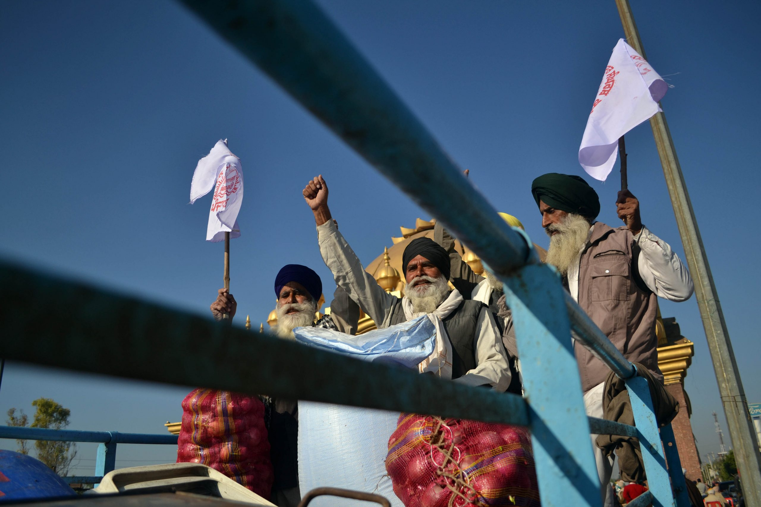 Farmers shout anti-government slogans as they get ready to leave for New Delhi to join the nationwide protest against new legislation passed by centre government in Amritsar, Punjab, India 27.11. 2020