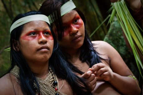ORELLANA, ECUADOR - AUGUST 10, 2012: Two young girls form huaorani tribe in the amazon rainforest, Yasuni National Park, Ecuador