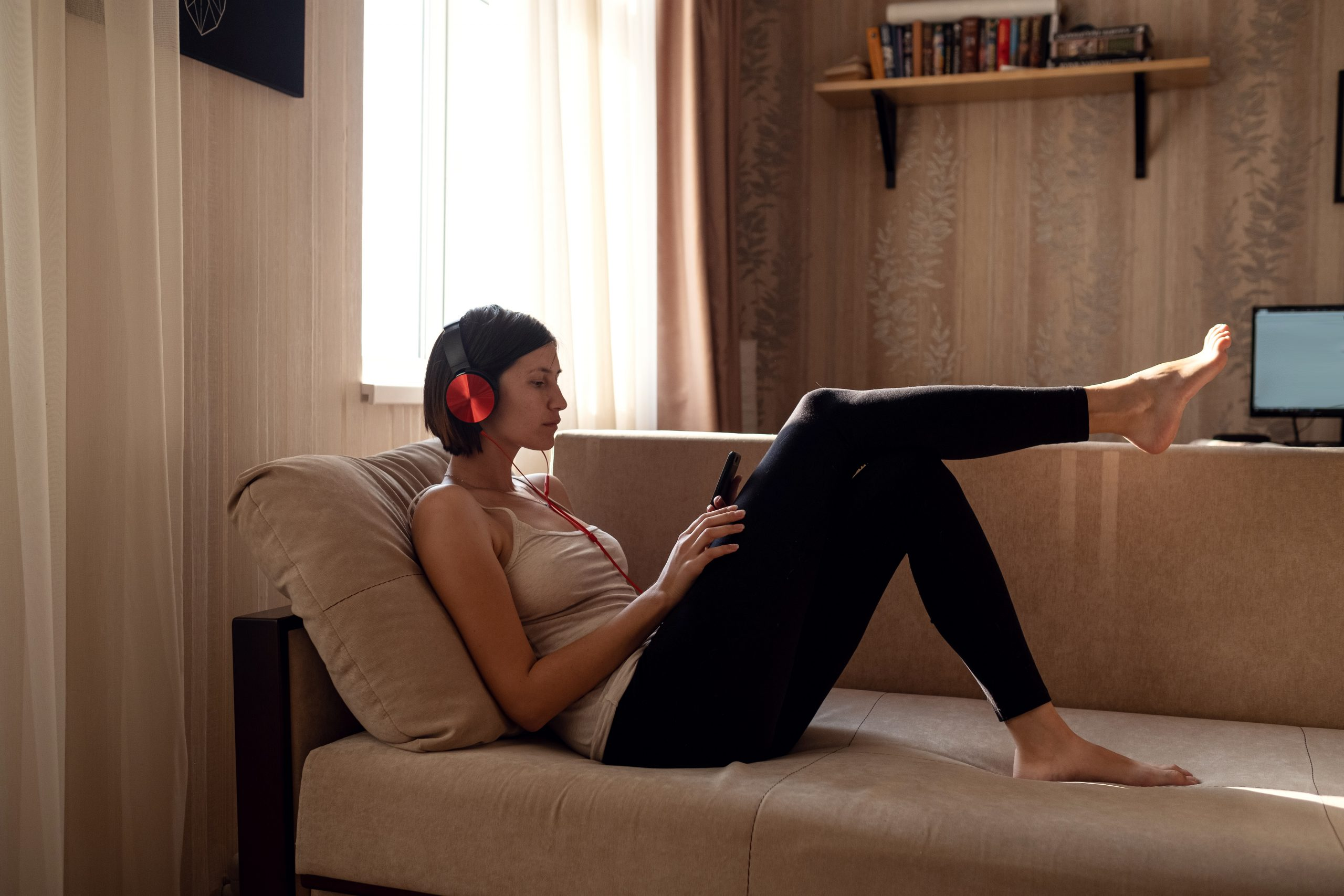 Girl on phone on couch