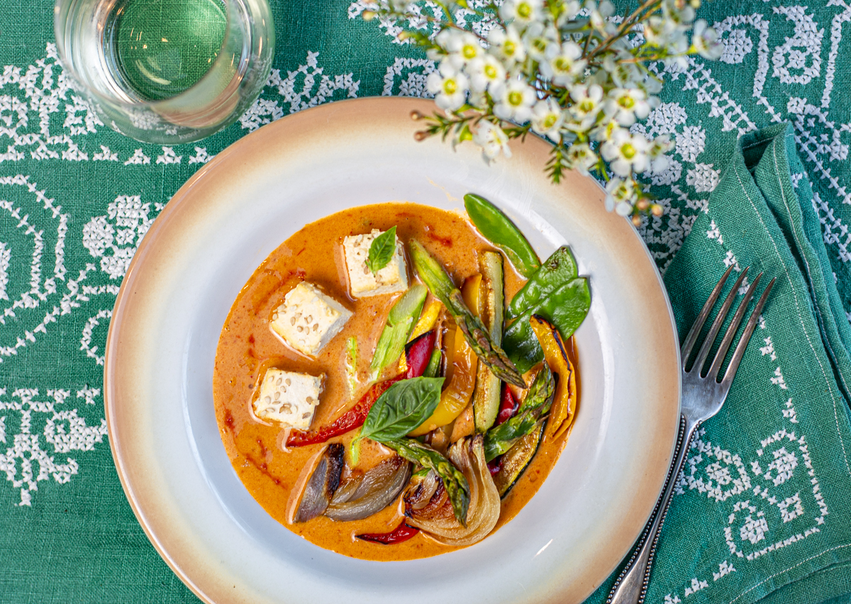 Red Coconut Curry with Sesame Tofu & Roasted Vegetables in vintage bowls and linens