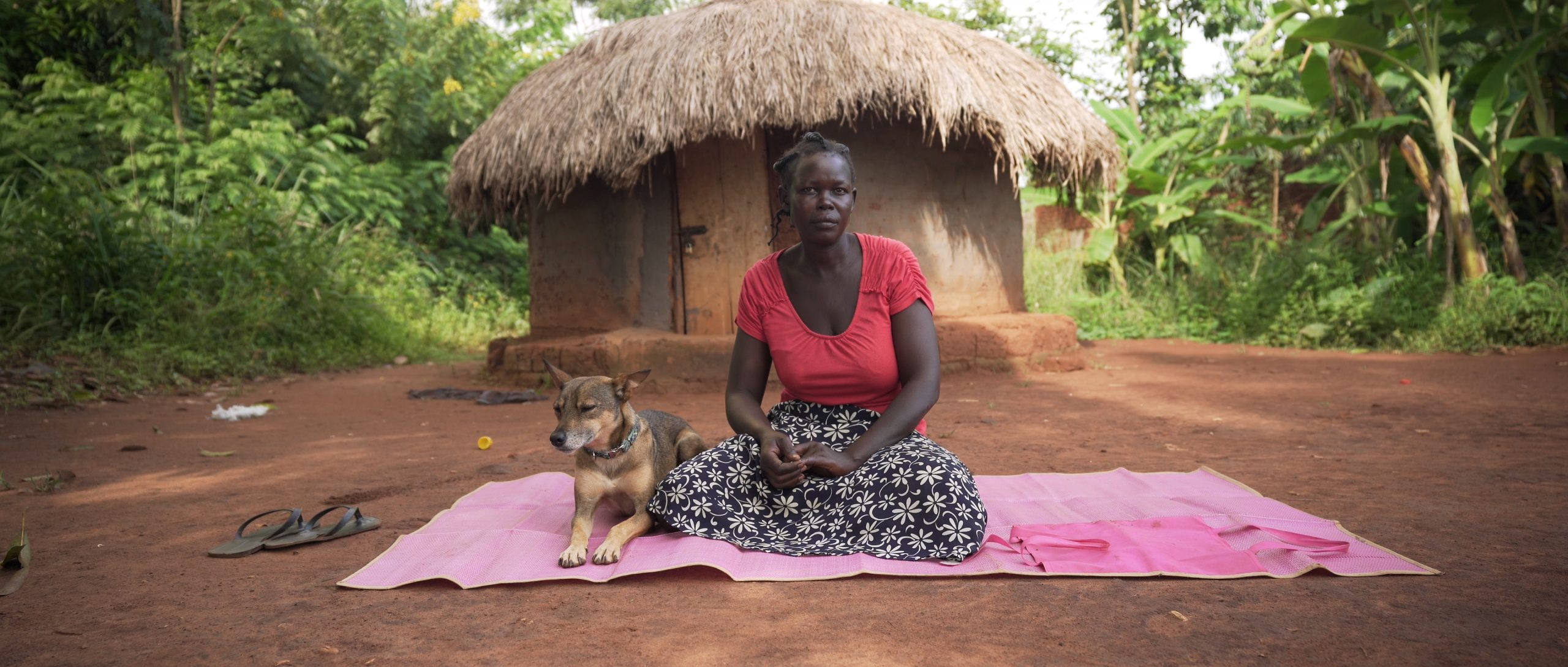 Lucy, a former Ugandan child soldier, with her dog Sadik (courtesy Urtext Films)