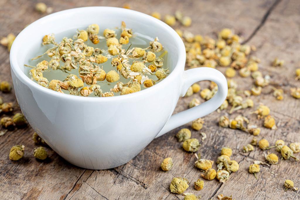 White cup of chamomile tea