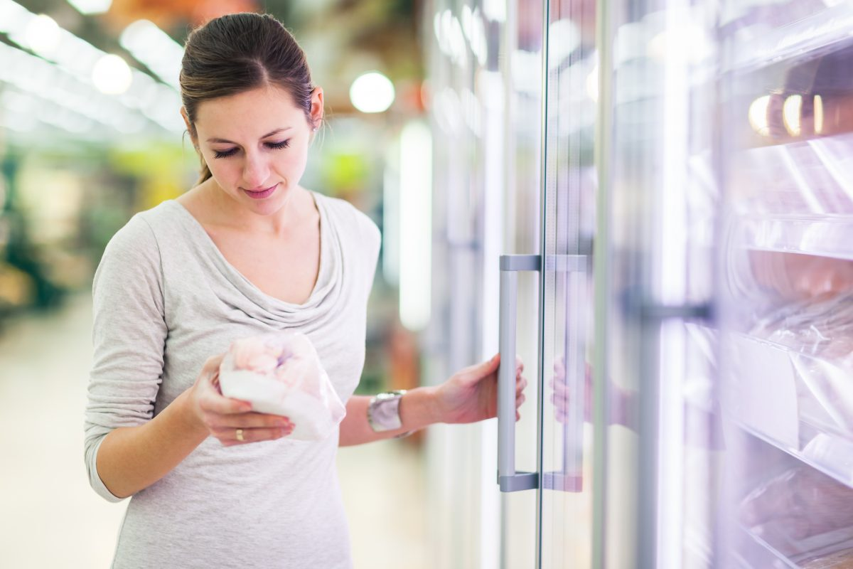 grocery store woman with frozen chicken